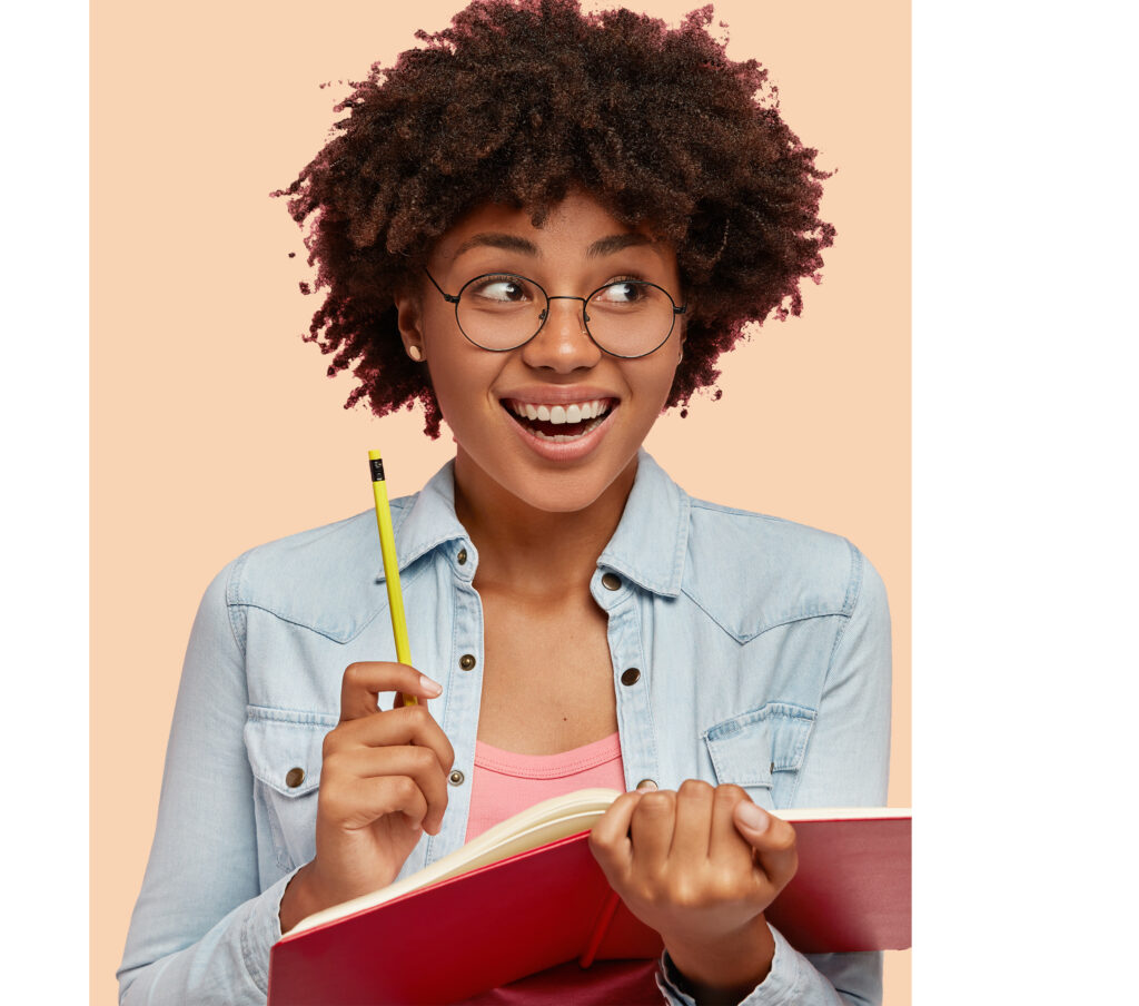 Joyful black author works on writing new book for readers, has positive expression, inspiration to work and create, carries notepad and pencil, isolated over pink background with free space for text